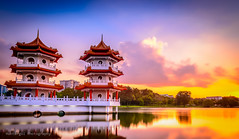 Twin towers in lovely moment (huntergol) Tags: yellow sunset water travel cloudy singapore lightroom asian landmark streetphotography chinese nisi