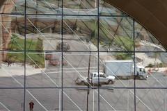 01 Illusion: Chestnut Street Reflected in Museum Window (Adventure George) Tags: city urban usa newyork us spring unitedstates unitedstatesofamerica upstate rochester upstatenewyork newyorkstate urbanscenes chestnutstreet centralbusinessdistrict citystreet nikond700 photogeorge