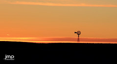 Sunset on the Prairie (Jeff Meeker) Tags: sunset orange water windmill yellow contrast colorado peaceful pasture yuma wray eckley highway34 outdoorphotography colorfulcolorado yumacounty groupwithexperience