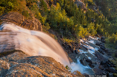 Precarious Position (kevin-palmer) Tags: county autumn trees light sunset wild mist lake fall yellow creek gold golden evening waterfall montana rocks stream drop falls mission flowing rugged precarious missionmountains flatheadindianreservation samyang kevinpalmer pentaxk5 bower14mmf28