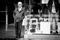 Skinny Living (Leanne Boulton) Tags: life street old city light portrait people urban blackandwhite bw white man black male eye mannequin window monochrome face sunglasses sign shop contrast writing canon reflections skinny mono scotland living blackwhite store high display expression glasgow candid scene shades human elderly age shade angry older contact aged bandw miserable grumpy leaning facial vision:people=099 vision:face=099 vision:text=0584 potd:country=gb vision:outdoor=0912