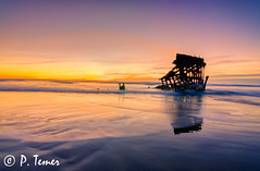 Ghostly Reflection (Sol y Luz Photography (aka love_2_see_the_world)) Tags: sunset motion reflection beach oregon coast nw waves wintersunset northwest or pacificocean shipwreck goldenhour pacificnw waterinmotion warmsunset recedingwater