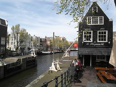 Cafe de Sluyswacht Amsterdam. (Flyingpast) Tags: travel blue vacation sky people holiday holland building tourism public water netherlands amsterdam architecture boat canal spring cafe europe famous houseboat rembrandt waterway capitalcity citybreak 1695 wb2000 tl350