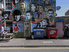 streets of brighton (maximorgana) Tags: street door people white playing celebrity art ass window yellow wall dumpster standing bench hair walking beard graffiti wire brighton sitting dish pavement 7 dirty line container loureed seven celebrities budha taking johnlennon antenna jamesbrown freddymercury colorinchi trashbit footballscratching