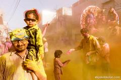 Cowboy and Tiger (Jakob Kolar) Tags: street travel family india water colors yellow festival asia colours child father religion celebration hindu indien colorfestival mathura holifestival uttarpradesh festivalofcolours