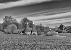 Oast Houses (sussexscorpio) Tags: trees houses sky blackandwhite building brick monochrome field stone architecture clouds brewing canon landscape mono countryside oast kent outdoor towers kiln drying hops kilning gardenofengland canon60d