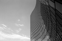 glass & sky (niki altmann) Tags: vienna leica sky bw building tower film glass architecture analog silver mirror blackwhite xp2 monochrom ilford mda 21mm voightlnder einfrbig pureartworkwithoutend
