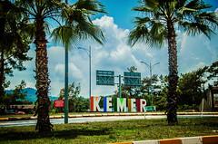 Not really Kemer (Melissa Maples) Tags: trees sign clouds turkey nikon asia text trkiye palm palmtrees nikkor vr afs kemer  18200mm tekirova  f3556g  18200mmf3556g d5100