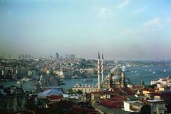 Looking northeast from above a han (//sarah) Tags: film turkey turkiye istanbul bosphorus fatih karaky grandbazaar galatabridge beyolu eminn yenicami newmosque kapalar minoltasrt100 bykvalidehan bykar abovethegrandbazaar