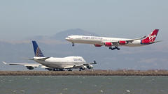 """The Pencil"" and ""The Queen"" (aguayo) Tags: sf sanfrancisco california uk england london pencil plane germany airplane airport sfo united jet taxis queen landing airbus bayarea boeing arrival lands takeoff arrives waits 747 airliner a340 virginatlantic 747400 frankfort jetliner taxiing ksfo a340600 quadjet"
