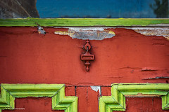 Red Green Door (Jae at Wits End) Tags: door old red color building green texture architecture hardware peeling paint pattern decay entrance structure pale doorway faded worn weathered opening portal shape cracked entry bleached faint textured discolored