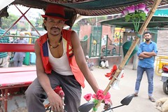 A Portrait of The Delhi Walla as a Rickshaw Puller (Mayank Austen Soofi) Tags: portrait flower hat delhi rickshaw puller walla