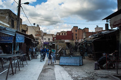 NEAR LIGHT (DanielO'Donnell & AbiPonceHardy) Tags: street city blue sky playing metal clouds children photography streetphotography morocco meknes