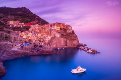 Manarola at Sunset (A Camera Story) Tags: longexposure italy twilight europe mediterranean liguria it unescoworldheritagesite cinqueterre nationalparks manarola italianriviera cinqueterrenationalpark singhraybluengoldpolarizer