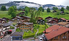 Swiss chalets in Grindelwald (somabiswas) Tags: alps tourism clouds switzerland scenery swiss grindelwald chalets berneseoberland inlovewithswitzerland