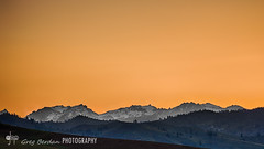 Orange sky over the spine (Greg Berdan) Tags: sky orange snow mountains twilight stuart jagged spine range ridgeline