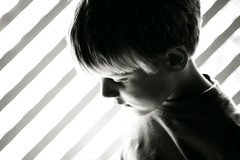 of the light (Pea Jay How) Tags: light boy blackandwhite bw children child diagonal backlit potrait