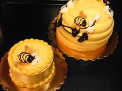 "Smash cakes are a additional $15.00 to the price of a larger decorated cake. Honeybee Cake (9"")In-Season..................................$31.95Off Season................................$37.95Honeybee design on smash cake.....included in $15.00 base price"