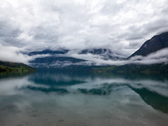 Norway: fjords, lakes and clouds #04 (Samuele Silva) Tags: travel blue sea summer panorama cloud house mountain lake mountains green tourism nature water beautiful norway fog clouds landscape lago coast pier fishing scenery europe mare view north cottage scenic tourist norwegian hut panoramica coastline fjord nordic peaks scandinavia residential picturesque lofoten geiranger romsdal rorbu hellesylt costaluminosa costaphotoblogtour