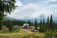 Rural mountain landscape (Anton_ua) Tags: travel summer sky cloud house mountain building green history nature beauty horizontal rural landscape outdoors woods day village farm traditional hill lawn culture scene national valley cloudscape scenics locations settlement fores nonurban