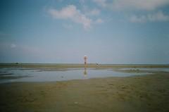 Gerra (Xavier Roeseler) Tags: sea colour reflection film beach analog canon san ae1 playa solo ethereal vicente scape comillas gerra