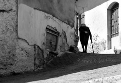 Does the road bend up-hill all the way? (Photography by Julia Martin) Tags: blackandwhite bend streetphotography crete oldlady uphill 1000views supershot impressedbeauty oldwidow canon5dmarkiii photographybyjuliamartin lpbend