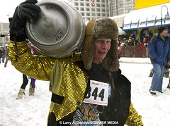 Alaskan Racer Carries Beer Keg Across Finish Line - Running of the Reindeer (Bower Media) Tags: snow alaska anchorage happyhour beerkeg iditarod 2013 ceremonialstart runningofthereindeer brightyellowjacket larrydonoso bowermedia larryadonoso photolarryadonoso bowermediaphotos