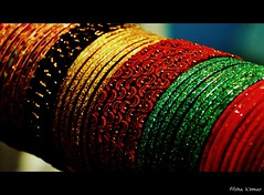 """Shimmering Moons - """"One could not count the moons that shimmer on her roofs, Or the thousand splendid suns that hide behind her walls.""""   ― Khaled Hosseini, A Thousand Splendid Suns (@mons.always) Tags: stilllife nikon jewelery bangles coloful d90 18105mm"""