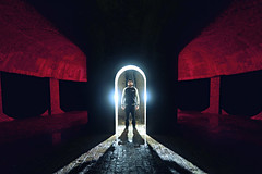Subterranean (Subversive Photography) Tags: selfportrait lightpainting colour brick london architecture self underground arch darkness flash atmosphere urbanexploration underworld subterranean cinematic gels urbex stygian cimmerian danielbarter