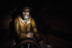 yarr (Fine Detail Films) Tags: art wheel canon beard boat raw ship 28mm fineart highcontrast sigma captain 7d manual sailor f18 nocrop raincoat helm lightroom rainhat manualprocess igodownwithmeship