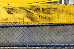 Parking garage #1 (aleadam) Tags: yellow fence garage parking bumper guardrail scratch