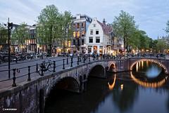 Amsterdam. (alamsterdam) Tags: longexposure reflection amsterdam evening bikes bluehour brige keizersgracht leliegracht