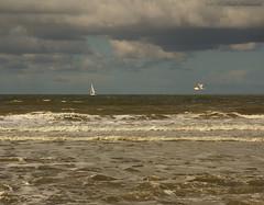 Belgian coast (Natali Antonovich) Tags: sea sky bird nature water landscape boat seaside waves seagull horizon northsea oostende seashore seasideresort belgiancoast seaboard