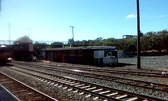 7SM5 - PacificNational freight arrives to cross XPT at Albury. 15/05/2016 (SHANERROL) Tags: pa albury freighttrain xpt passengertrain pacificnational 8210 8226 australiantrains dl40 trainsinnewsouthwales
