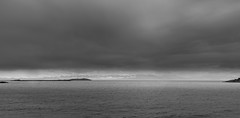 Trial Island to the Fore, Olympic Mountains to the Aft. (James McBean Photography) Tags: ocean sea sky blackandwhite seascape mountains nature water monochrome clouds landscape outdoor britishcolumbia vancouverisland cloudporn victoriabc greyscale olympicmountains trialisland skyporn