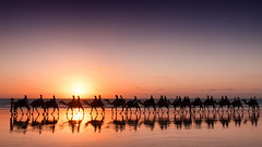 The end of the ride (Pat Charles) Tags: ocean travel sunset sea sky reflection tourism beach water train reflections evening sand nikon skies ride dusk australia clear reflected riding camel wa 1001nights camels westernaustralia broome cablebeach