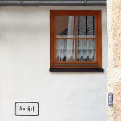 am hof (fourcotts) Tags: fourcotts square olympus omd em5 hallstatt austria salzkammergut amhof walls window lace curtain reflection gutter 111