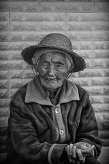 the survivor~ Yunnan (~mimo~) Tags: china old portrait woman face hat straw stroke worker yunnan paralysed