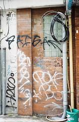Sukhumvit Rd - Bangkok (35mm) (jcbkk1956) Tags: street streetart film wall analog 35mm thailand graffiti bangkok manual streetfurniture carlzeiss kodacolor200 contaxrts 45mmf28