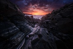Ocean Sunset (Arvid Bjrkqvist) Tags: ocean sunset sea sky colors clouds dark evening coast rocks mood sweden dusk horizon perspective vivid cliffs textures bluehour hovshallar