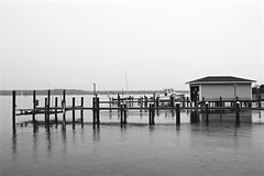 IMG_4023 (echoey13) Tags: blackandwhite bw reflection monochrome rain canon reflections boats bay pier boat md piers maryland raindrops boathouse edgewater raindrop 2016 canon70d