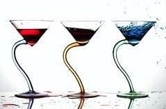 Making a Mess (Karen_Chappell) Tags: blue red stilllife white 3 glass glasses three triangle curve spill liquid