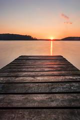 The Lake (bhansen.kiel) Tags: wood blue sunset red sky cloud sun lake reflection germany see sonnenuntergang jetty himmel wolke holz schleswigholstein steg westensee schierensee
