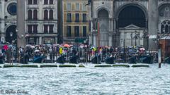Rain empties the Gondolas (stephencurtin) Tags: venice italy rain empty lagoon umbrellas gondolas