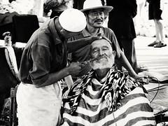 Trimming the mustache (__Thomas Tassy__) Tags: kachgar china kashgar xinjiang chinese old man portrait outside barber hair cut people asian asia blanc noir black white chine chinois kodak