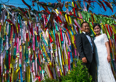 North korean defector joseph park with his south korean fiancee juyeon in front of messages of peace written on ribbons left on dmz, Sudogwon, Paju, South korea (Eric Lafforgue) Tags: men love horizontal fence outdoors hope freedom bride wire women ribbons couple colorful asia peace border security korea flags weddingdress multicolored southkorea messages barbed 2people twopeople dmz adultsonly zone frontier inlove northkorea paju jsa taegukgi fiancee hoping suitjacket defector lookingatcamera demilitarizedzone militarydemarcationline sudogwon lifeevent colourpicture unificationpark yovel josephpark imjingakresort imjingakvisitorcentre sk162196