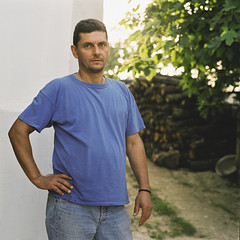 Portrait of a greek villager (Nasos Zovoilis) Tags: door wood flowers summer vacation portrait people plants holiday man male guy green history film window nature businessman stone wall modern work mediumformat dark hair french outdoors happy person corporate one freedom healthy hands long fuji village hand estate arms adult stones rustic joy young lifestyle sunny athens front historic full business hasselblad greece friendly environment customer worker summertime farmer charming employee villager caucasian 400h