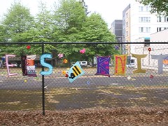 MVI_7860 (Eugene Knotty Knitters) Tags: flowers streetart graffiti knitting eugene uo universityoforegon eugeneoregon knitgraffiti knottyknitters guerrillaknitting yarntag yarnbombing yarnbomb eugeneknottyknitters