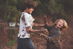Payback time! (Adriana Varela Photography) Tags: boy playing boys war mud little brothers brother wrestling dirty dirt stains muddy