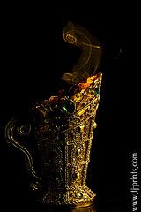 Censer IX (TJ.Photography) Tags: lamp metal handle fire gold golden shiny glow perfume shine treasure stones metallic smoking burning flame burn ornament smell oriental orient smoker burner artifact aromatic item incense luster jewel odor artefact aroma engrave smelling censer cense